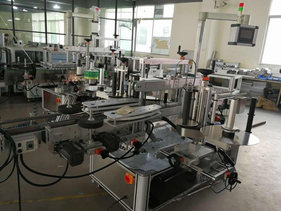 फार्मास्यूटिकल कार्टनहरूको लागि उच्च स्पीड डुअल कुना सील लेबलिंग प्रणाली