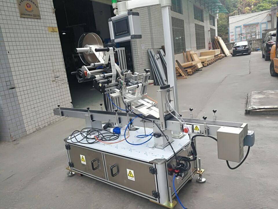 नोजल पाउच इलेक्ट्रिक चालित प्रकारको लागि स्टीकर शीर्ष लेबलिंग मेशीन